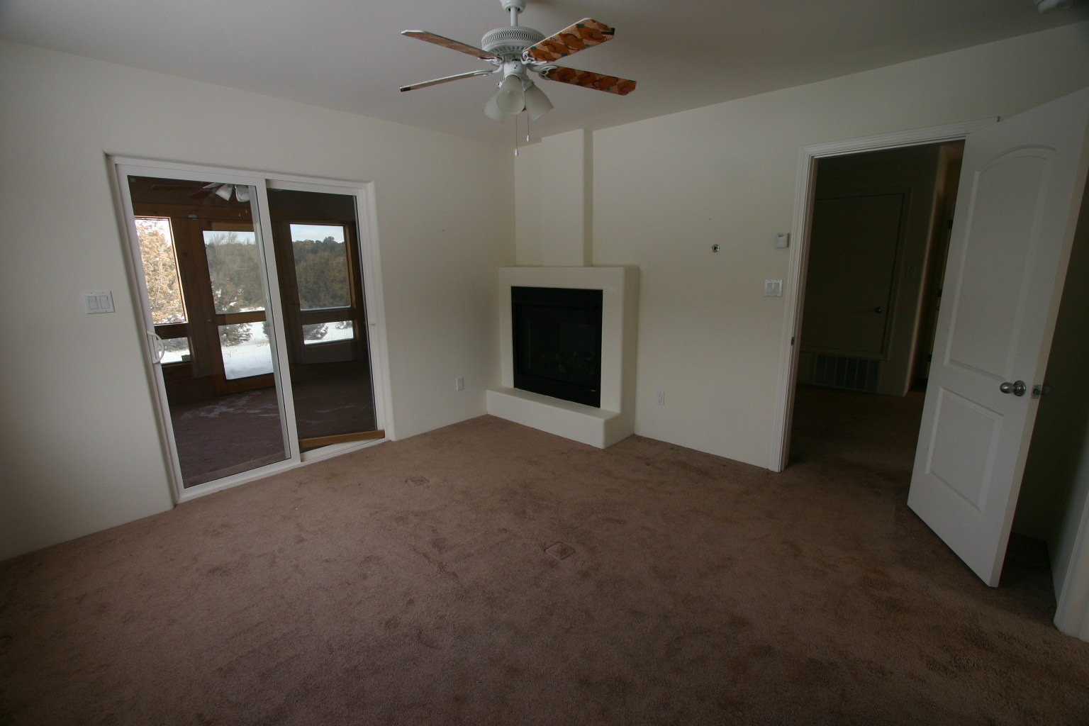 Master Bedroom has gas log fireplace.